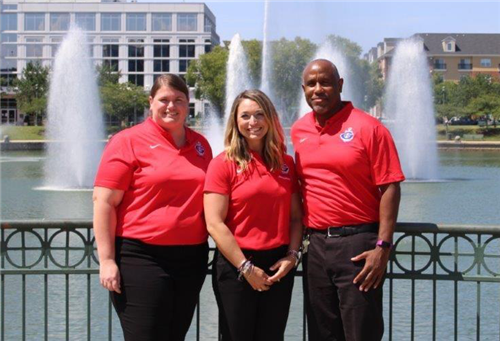 Dr. Abbie Marting, Whitney Cataldo and George Page standing infron of at large fountain
